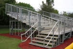 Elevated aluminum bleachers for a baseball field